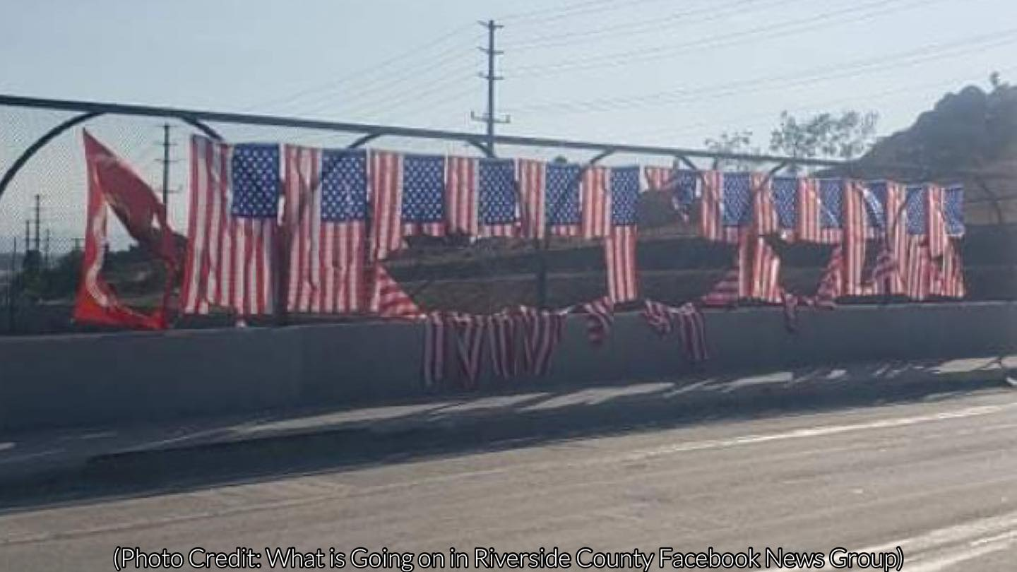 American flags of a memorial desecrated by a vandal